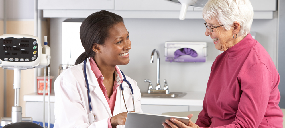 woman reviewing her charts with her doctor